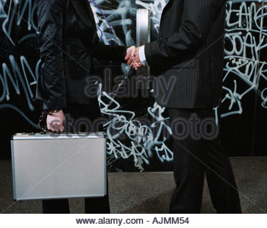 Gangsters shaking hands - Stock Photo