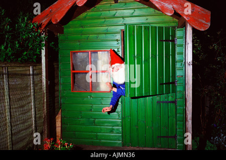 garden gnome inside shed stock photo