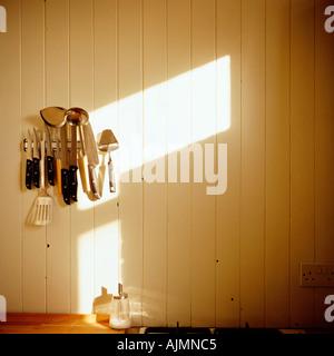 Kitchen utensils on wall - Stock Photo