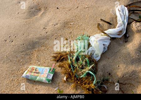 pollution on sand of beach - Stock Photo