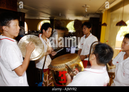 Chinese Malaysians play for the Southern Lion Dance on new years day. Batu Ferringhi, Penang Island, Malaysia. - Stock Photo