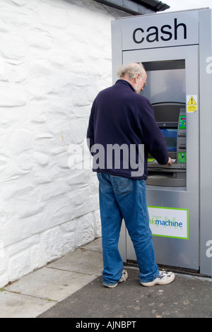 Man using a cash machine - Stock Photo