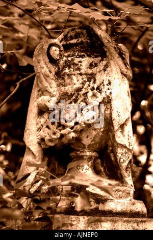 Gravestone in Tower Hamlets Cemetery Park London - Stock Photo