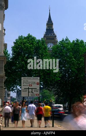 Pedestrians walking near Big Ben in London city England UK - Stock Photo