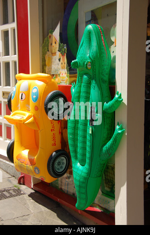 Inflatable beach toys outside a shop, UK - Stock Photo