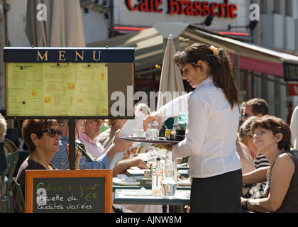 French alfresco Waitress serving customers in outdoor cafe with menus in Beaune centre, Burgundy, Cote d'Or, France - Stock Photo