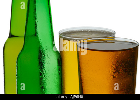 BEER COLORFUL GREEN BOTTLES OF COLD BEER FULL SILHOUETTED ON WHITE BACKGROUND - Stock Photo