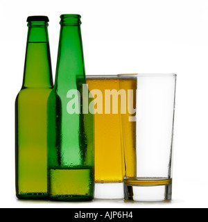 BEER COLORFUL GREEN BOTTLES OF COLD BEER FULL AND EMPTY SILHOUETTED ON WHITE BACKGROUND - Stock Photo