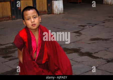 A student monk at the Paro Dzong monastery in Bhutan - Stock Photo