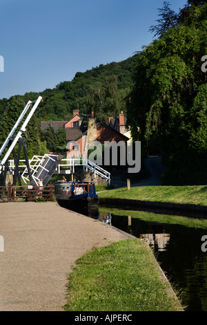 Narrowboat Passing a Lift Bridge on the Llangollen Canal at Froncysyllte North Wales - Stock Photo