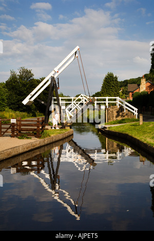 Woman Opening a Lift Bridge on the Llangollen Canal at Froncysyllte North Wales - Stock Photo