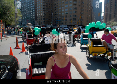Pedicab drivers in Columbus Circle in NYC - Stock Photo