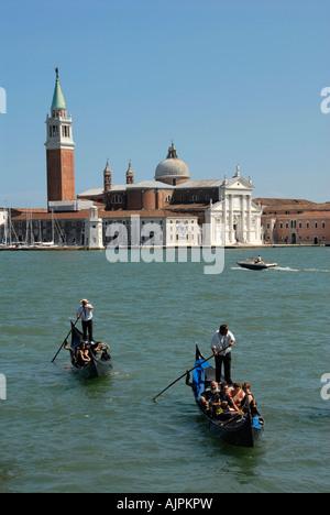 Two gondolas and San Giorgio Maggiore Venice Italy - Stock Photo