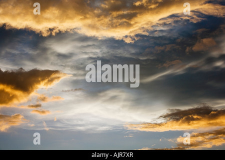Sunset storm clouds in India. Indian cloudy sky in the evening sunlight - Stock Photo