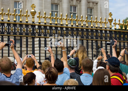 Buckingham Palace London tourists try to photograph the Changing of the Guard - Stock Photo