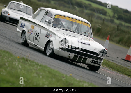 Paul Gray from Dublin in his white 1 6 Lotus Cortina at Kirkistown Circuit county down Northern Ireland - Stock Photo