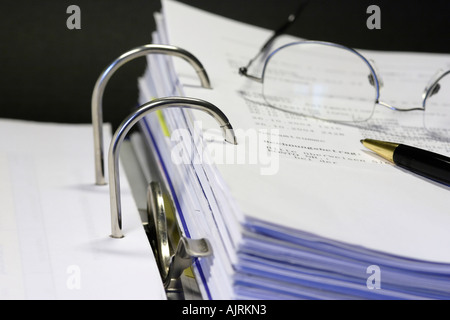 Open binder with different documents on black background - Stock Photo