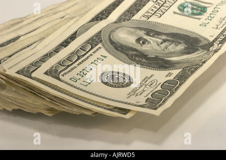 A stack of United States one hundred dollar bills on white - Stock Photo