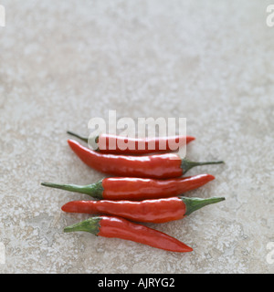 Red chillies on marble surface - Stock Photo