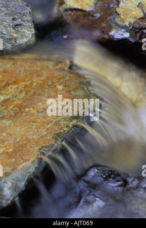 Water flowing over rocks - Stock Photo