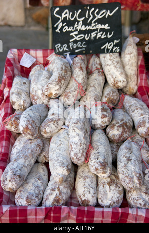 Saucisson for sale on a typical French market in the Herault, Languedoc Roussillon region of the south of France - Stock Photo