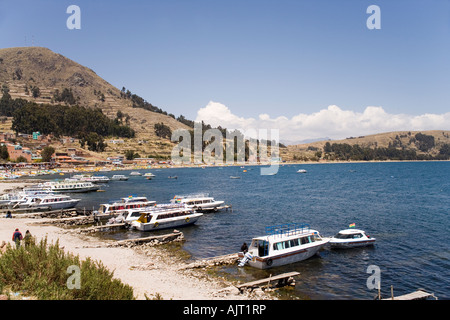 Beach and cruise boats at Copacabana a town on the shores of Lake Titicaca, Bolivia near the border with Peru - Stock Photo