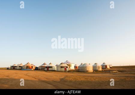 sunrise on a nomad yurt tents on the Xilamuren grasslands Inner Mongolia province China - Stock Photo