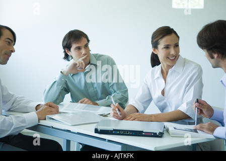 Business associates seated at table, chatting, cropped view - Stock Photo