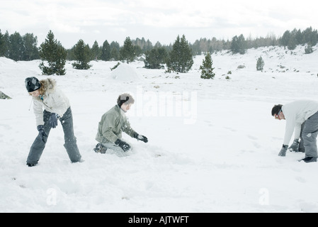 Young friends having snowball fight - Stock Photo