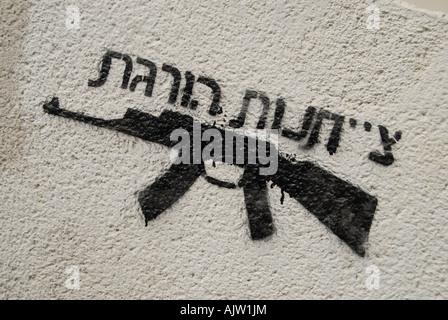 Anti war graffiti depicting AK-47 Kalashnikov machine gun with a written phrase in Hebrew reads' Obedience Kills' - Stock Photo