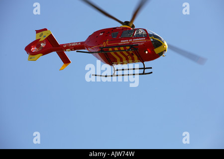 The County Air Ambulance helicopter G-HWAA coming in to land at its Worcestershire base - Stock Photo