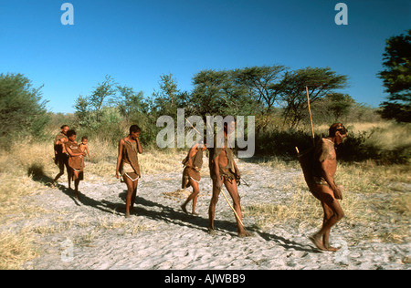 San family walking through Kalahari - Stock Photo