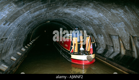 PICTURE CREDIT DOUG BLANE Simon Green navigating a narrowboat inside Blisworth tunnel on the Grand Union Canal Stoke - Stock Photo