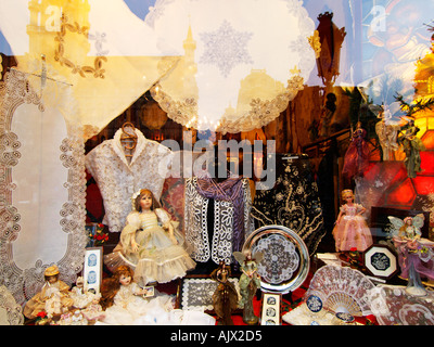 Shop window in Brussels with typical traditional lace products souvenirs Brussels Belgium - Stock Photo