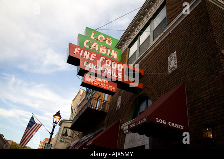 Old fashioned sign in Geneva illinois Log cabin fine food cocktails - Stock Photo