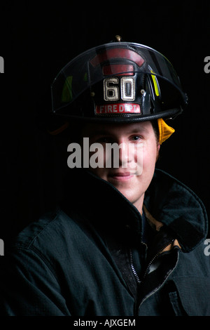 Young Fire Fighter portrait - Stock Photo