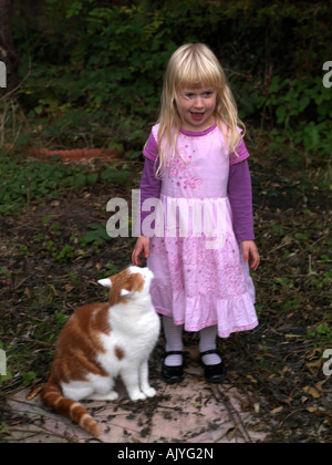 Four Year Old Girl With Her Pet Cat - Stock Photo