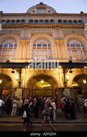 Spain Barcelona Ramblas opera house people facade illuminated at night - Stock Photo