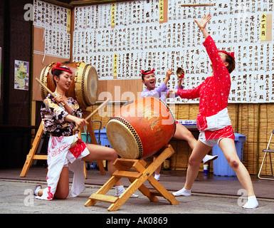 Group of girls playing drums in spectacular joyful animated graceful show Sanno Matsuri Festival Tokyo Japan Eastern - Stock Photo