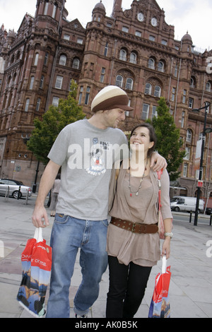 Manchester England UK Lower Mosley Street male female couple shopping - Stock Photo