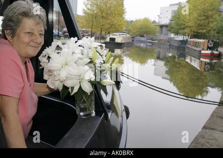 Manchester England UK Castlefield Bridgewater Canal long boat female resident houseboat - Stock Photo