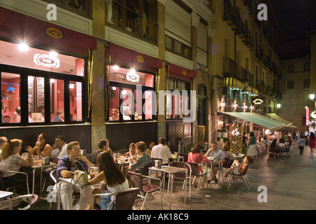 Sidewalk cafes and bars at night in the city centre, Madrid, Spain - Stock Photo