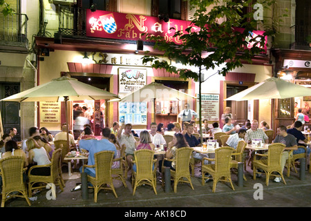 Sidewalk cafes and restaurants at night, Plaza Santa Ana, Madrid, Spain - Stock Photo