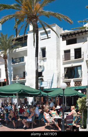 Harbourfront cafe in the Marina at Puerto Banus, near Marbella, Costa del Sol, Andalucia, Spain - Stock Photo