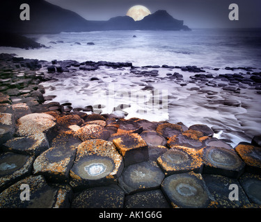 GB - NORTHERN IRELAND:  Moon over Giant's Causeway - Stock Photo