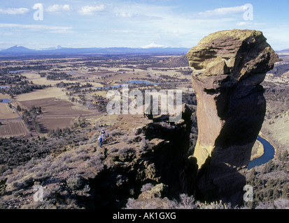 Two young hikers enjoy the view from Monkey Face in Smith Rock State Park - Stock Photo