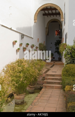 The exit from the Mondragon Palace, Ronda, Spain into the gardens. - Stock Photo