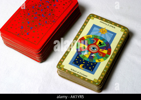 The Wheel of Fortune card and a pack of tarot cards. - Stock Photo