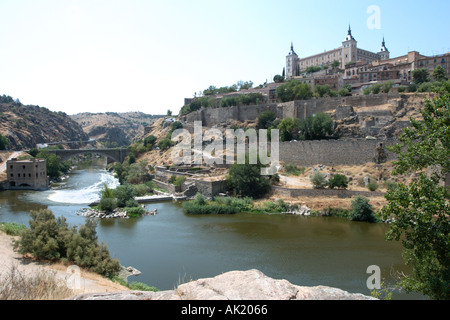 View over the River Tagus with the Alcazar on the hilltop to the right, Toledo, Castilla-La-Mancha, Spain - Stock Photo