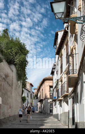 Cobbled street in the Albaicin (Albayzin) District, Granada, Andalucia, Spain - Stock Photo